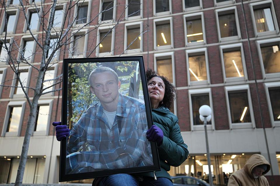 Boston, Ma., 01/25/2019, Nancy Tobin holds a photo of her son, Scott, who died at age 22 as a result of the opiod crisis. She and other families gathered out side the courthouse to protest Purdue Pharma. A status update in Suffolk Superior Court on the AG's suit against Purdue Pharma. A number of media organizations, including the Globe, argued that the judge should unredact additional information that is currently redacted in the AG's suit. Suzanne Kreiter/Globe staff