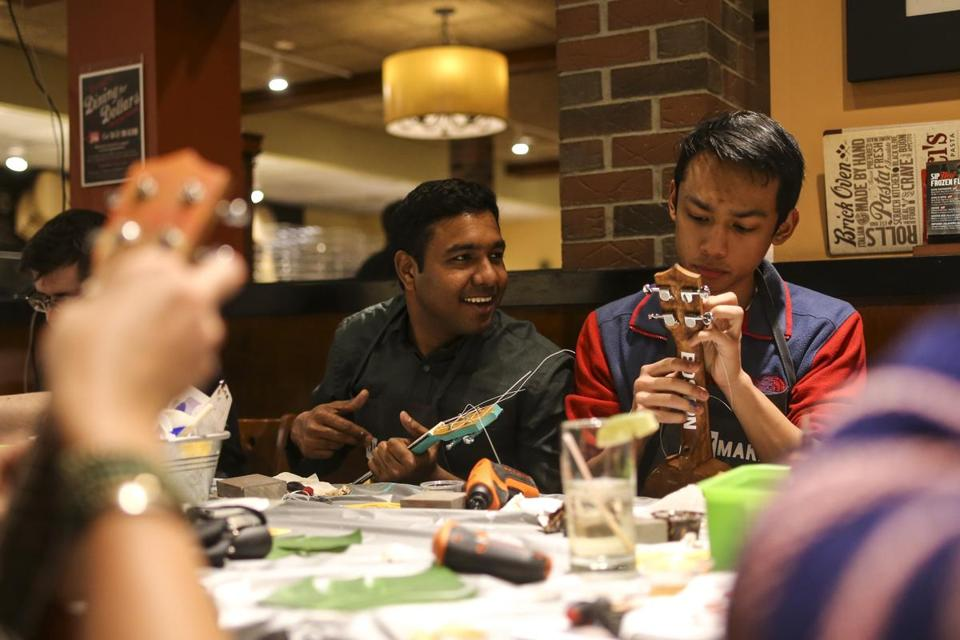 Thursday at Bertucci's in Kendall Square was ukulele-building night, an event put on by Somerville-based Yaymakers. The participants included Rajesh Sridhar (left) and Jed Tranate.