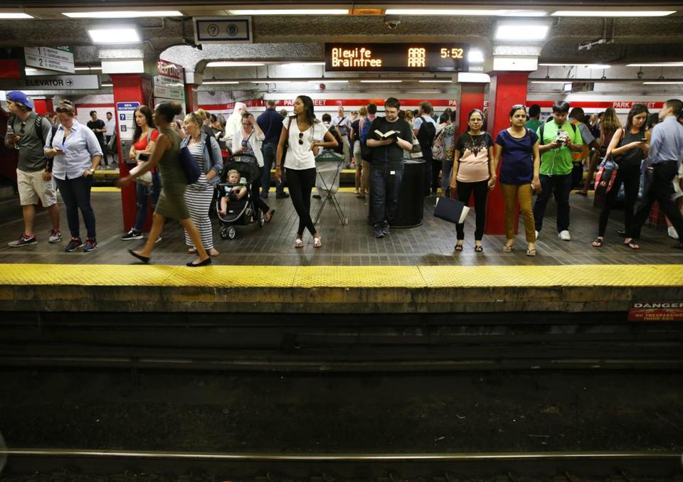 Commuters waited for a train on the MBTA Red Line at the Park Street Station.
