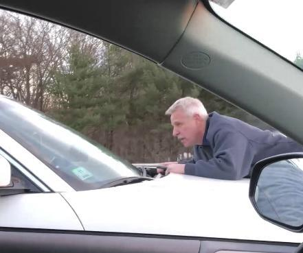 Man clings to moving SUV in road rage episode