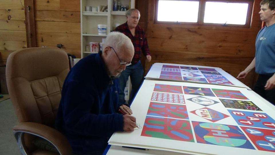 As he signed his work, Robert Indiana was accompanied by art publisher Michael McKenzie and Jamie Thomas, Indiana's caretaker. McKenzie and Thomas are the target of a lawsuit.
