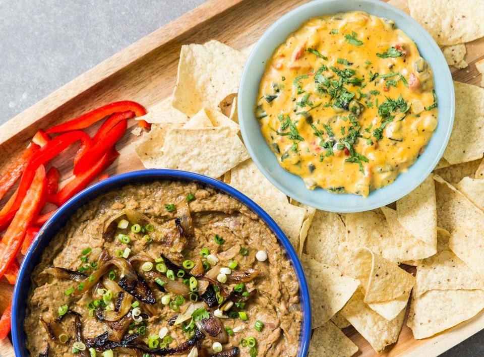 Pinto Bean Dip With Charred Onion and Chipotle, left, and Chile Con Queso, Tex-Mex Style.