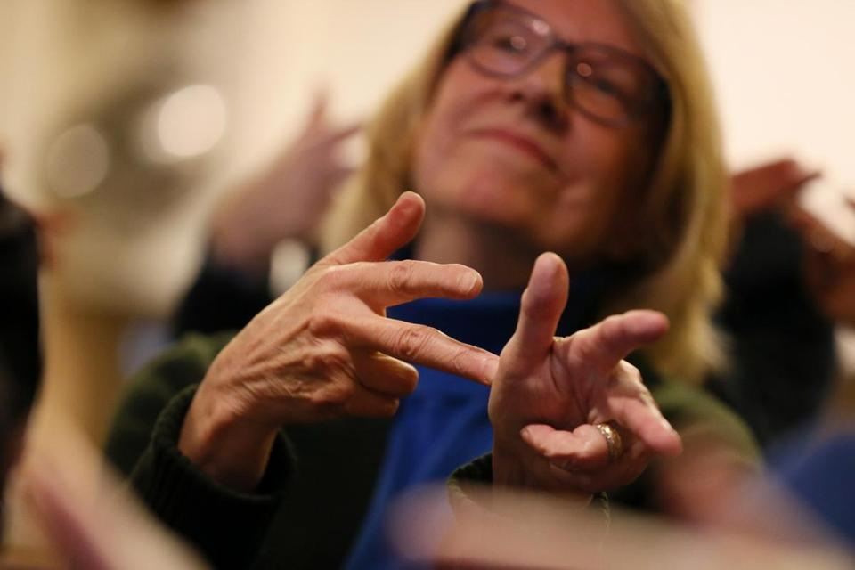 Jill McNeil learns the sign for car accident during a sign language class at a neighbor's home.