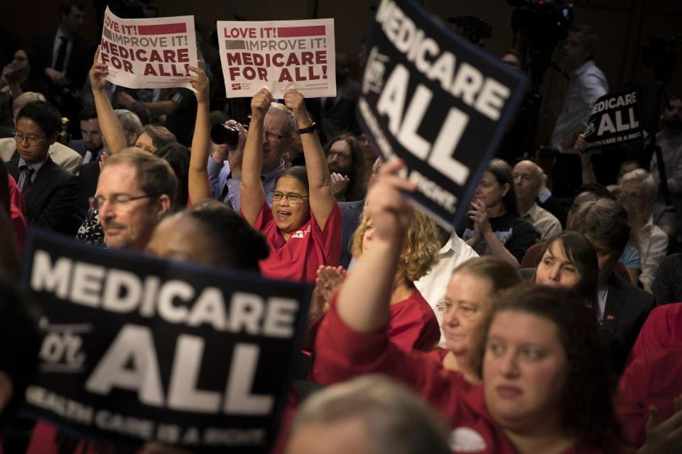 FILE — Nurses hold up signs supporting Medicare for All proposals at a rally on Capitol Hill in Washington, Sept. 13, 2017. The question of whether to support a single-payer health care model has been one of the thorniest dilemmas for several Democrats considering a 2020 presidential campaign. (Tom Brenner/The New York Times)