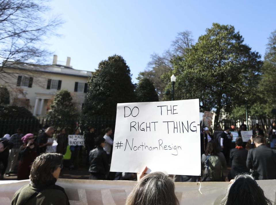 Protestors rallied Monday outside the governor's mansion in Richmond, asking Ralph Northam to step down.