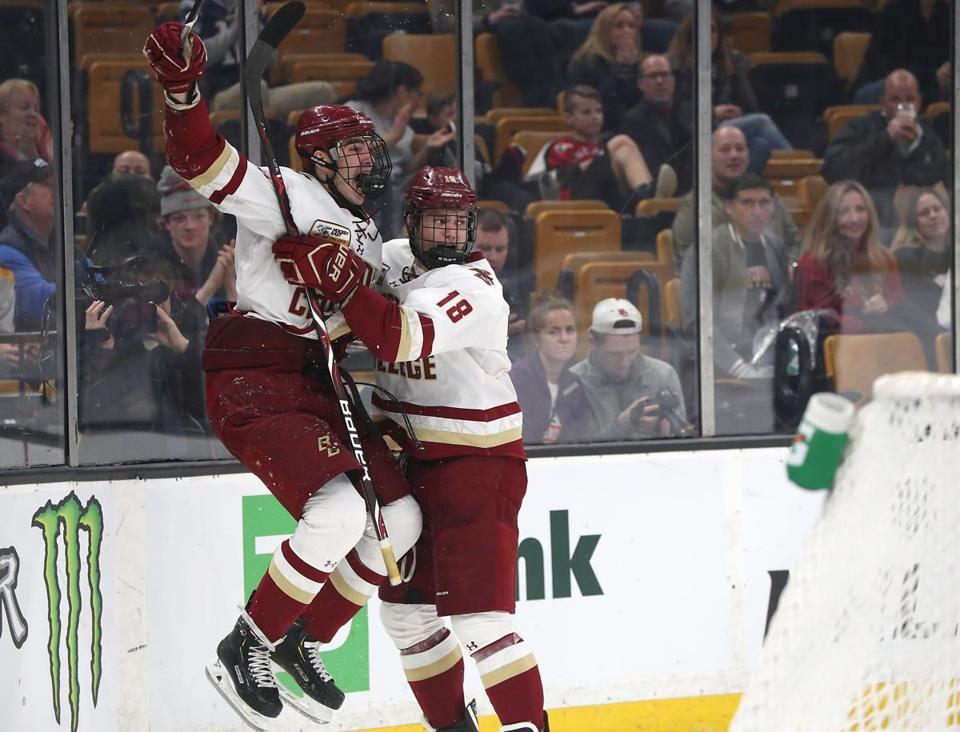 Freshman Jack McBain celebrated his winning goal with teammate Oliver Wahlstrom in the first round of the Beanpot.