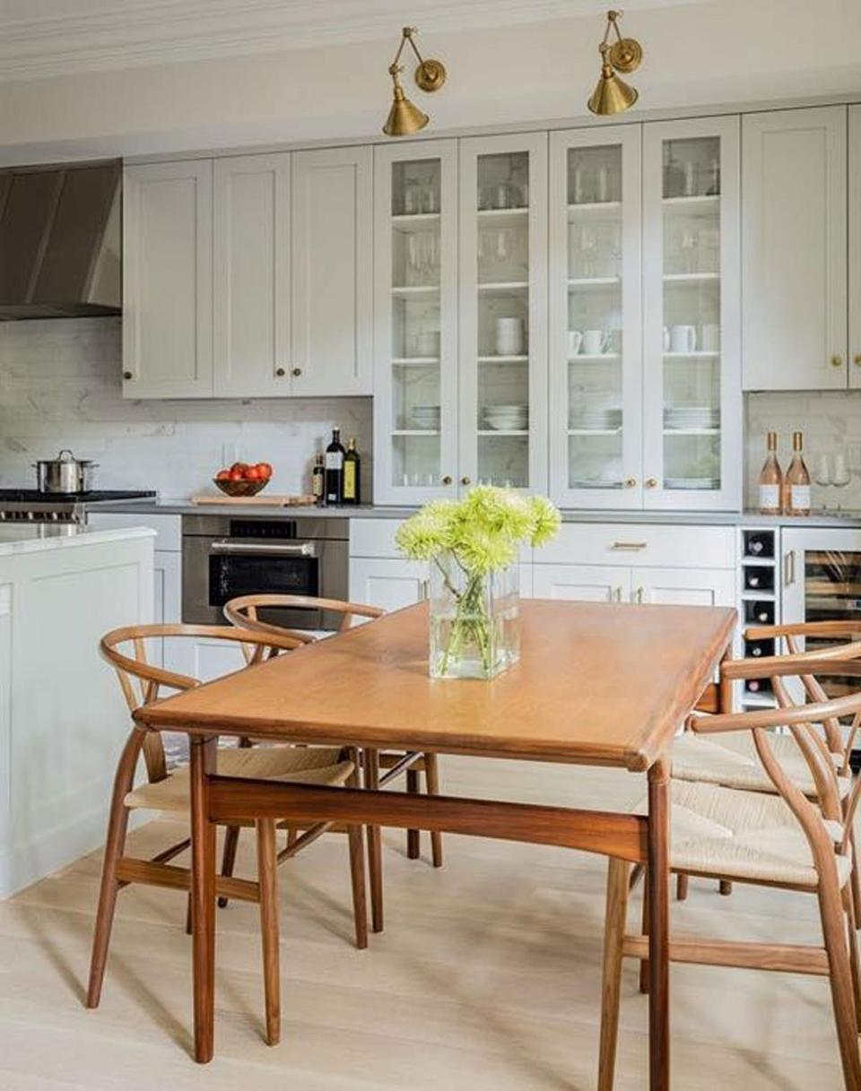Wishbone chairs surround the vintage Danish modern dining table.