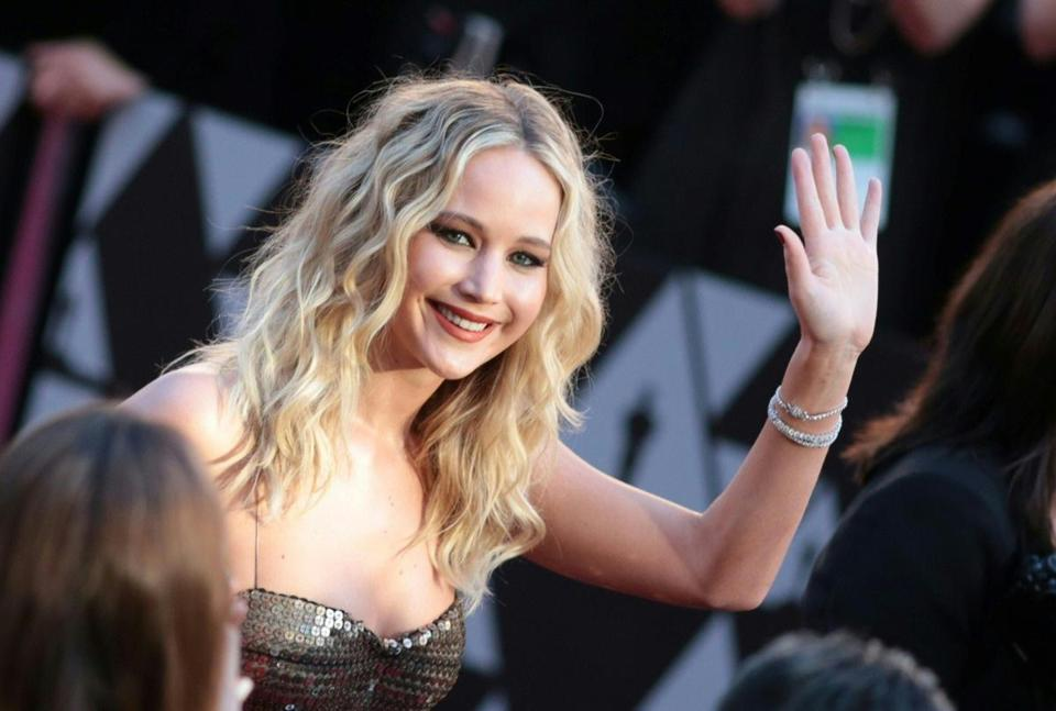 "(FILES) In this file photo taken on March 4, 2018 actress Jennifer Lawrence arrives for the 90th Annual Academy Awards in Hollywood, California. - Oscar-winning actress Jennifer Lawrence, one of Hollywood's most eligible singles, is tying the knot. The 28-year-old ""Hunger Games"" star is engaged to art dealer Cooke Maroney, 33, her publicist told the Los Angeles Times on February 6, 2019. The couple have been spotted together since last summer after reportedly being introduced through friends. (Photo by Kyle GRILLOT / AFP)KYLE GRILLOT/AFP/Getty Images"
