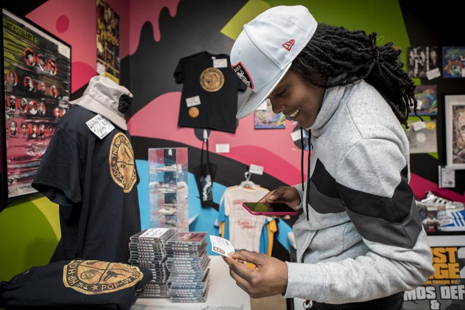 Tiara Jones looks at a variety of items on sale inside The Hip-Hop Museum, a Pop Up Experience on Wednesday, February 6, 2019. Jones traveled from Baltimore to visit her friend in Washington, D.C. to see the museum. Jeremy Beaver and David Mays founded the museum. The museum will only be open in D.C. until February 18, before it moves to other cities, including Boston. Beaver, owner of Listen Vision Studios in D.C., has worked with multiple hip-hop artists such as Lil Wayne, T-Pain, Doug E. Fresh and KRS-ONE among others. Mays is the founder of The Source Magazine, a magazine devoted to rap and hip-hop music and culture. John Boal photo/for The Boston Globe