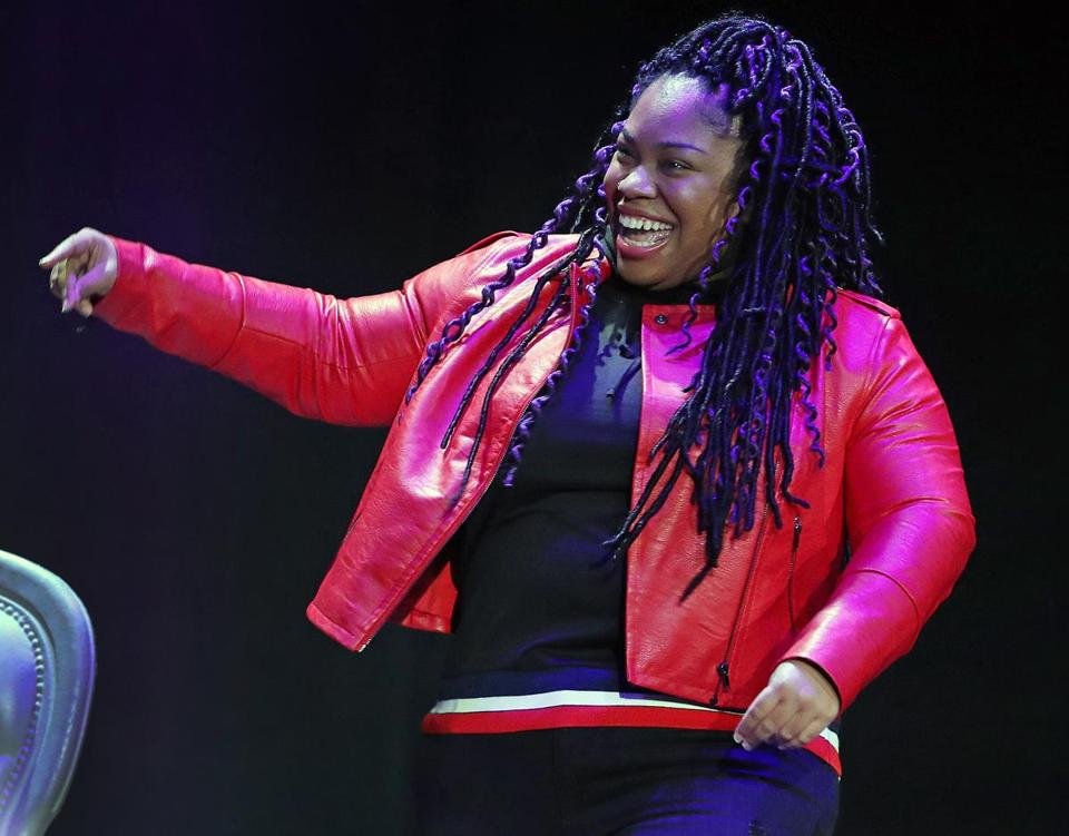 "2-7-19 Boston, MA: Author Angie Thomas is pictured as she does a litttle dance as she takes the stage at an event at the Wilbur Theatre where she was promoting her book ""On the Come Up'. (Jim Davis /Globe Staff)"