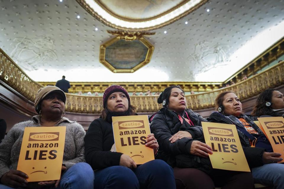 Protesters attended a New York City Council Finance Committee hearing on the new Amazon headquarters, slated to be built in Queens.