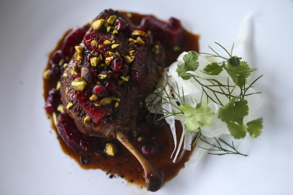 Duck leg a l'orange with blood orange, pomegranate, pistachio, and fennel salad.