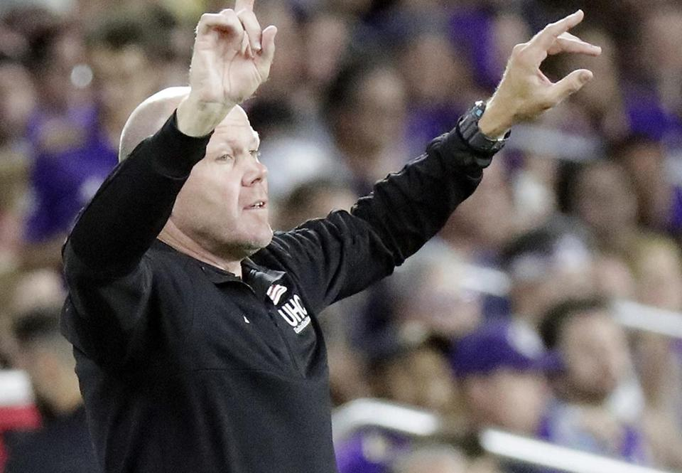 New England Revolution's Brad Friedel gestures to his players during the second half of an MLS soccer match against Orlando City, Saturday, Aug. 4, 2018, in Orlando, Fla. (AP Photo/John Raoux)