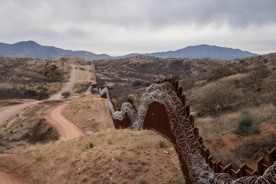 A general view of the US border fence, covered in concertina wire, separating the US and Mexico, at the outskirts of Nogales, Arizona, on February 9, 2019. (Photo by Ariana Drehsler / AFP)ARIANA DREHSLER/AFP/Getty Images