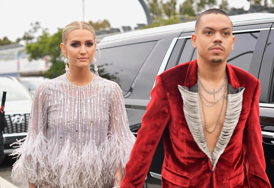 Ashlee Simpson (left) and Evan Ross arrived, with Ross apparently wanting to show off his chains.