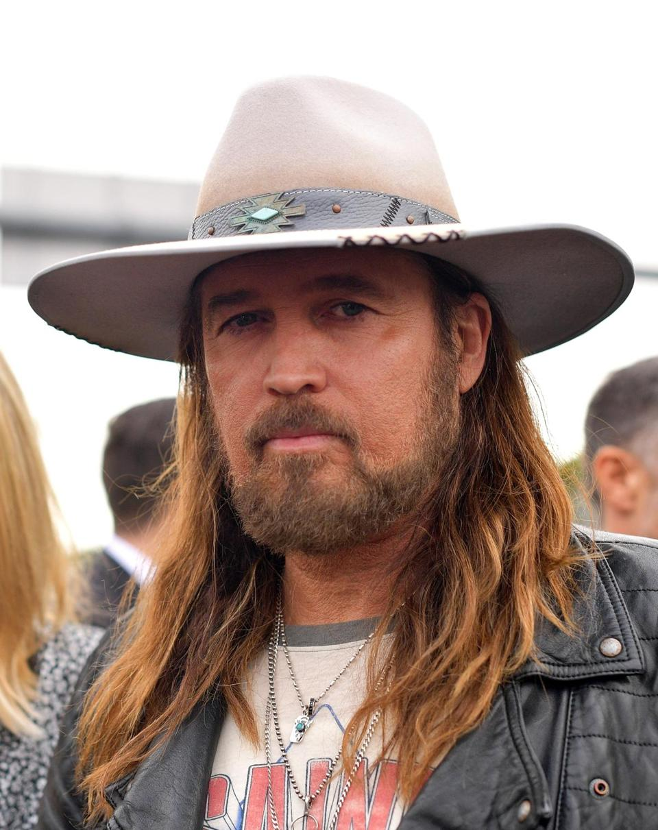 Country star Billy Ray Cyrus, attending with his more-famous daughter Miley, went for a simple look.