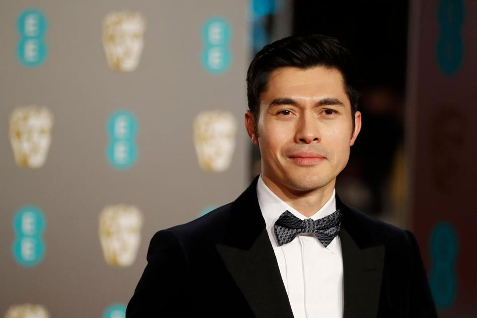 Actor Henry Golding poses on the red carpet at the BAFTA British Academy Film Awards at the Royal Albert Hall in London on Feb. 10, 2019.