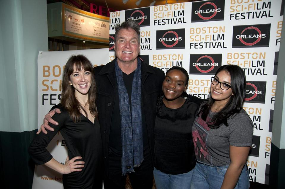 Actor Sam J. Jones poses with members of the Boston Sci-Fi Film Festival staff (from left): Elsa McLaughlin, Olivia Grant, and Tishna Lodi.