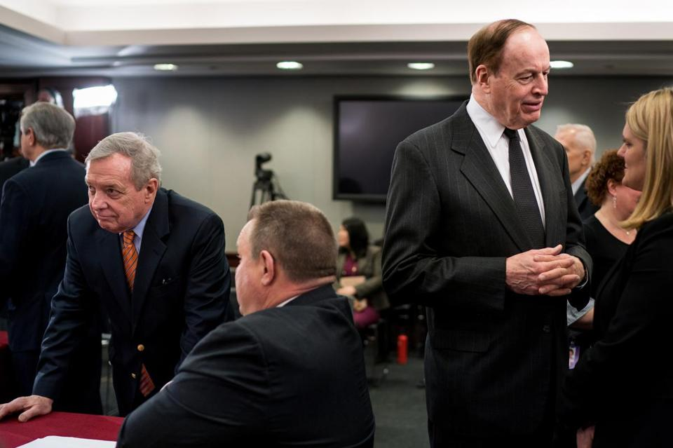 From left: Democratic Senator Dick Durbin of Illinois with Democratic Senator Jon Tester of Montana while Republican Senator Richard Shelby of Alabama spoketo an aide before the start of a Homeland Security Appropriations Conference Committee meeting Jan 30.