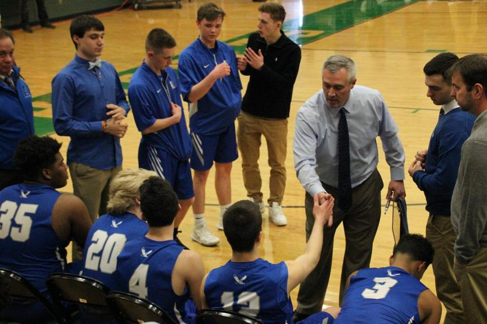 Attleboro coach Mark Houle shakes hands with his son, Mason, during a timeout earlier this season.