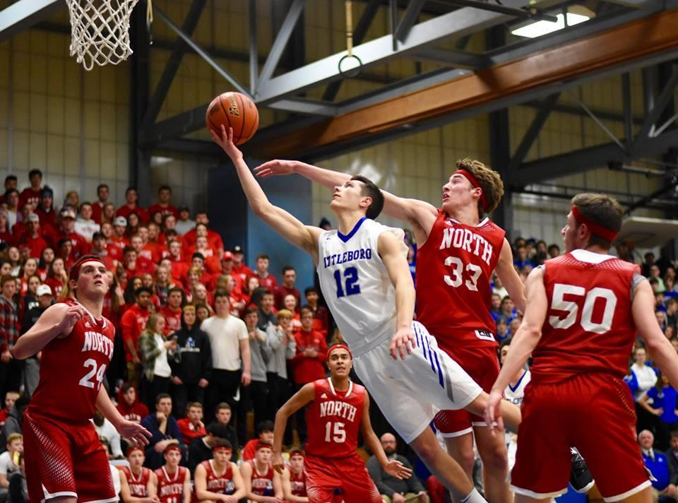 Attleboro's Mason Houle (12) drives to the basket against North Attleborough last month.