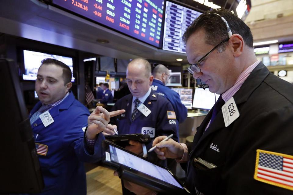 Specialist Gennaro Sapolito works with traders at his post on the floor of the New York Stock Exchange, Tuesday, Feb. 12, 2019. U.S. stocks are gaining in early trading after U.S. lawmakers reached a tentative deal to avoid another costly government shutdown. (AP Photo/Richard Drew)