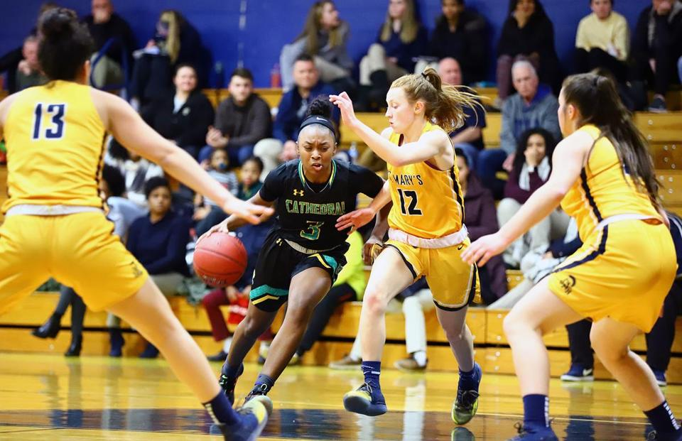 Cathedral's Amani Boston drives to the basket against St. Mary's defense. Mark Lorenz for the Boston Globe.