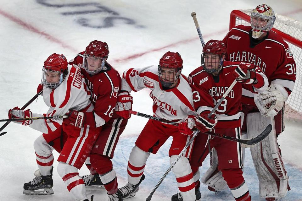There was a crowd in front of Harvard goalie Michael Lackey during third-period action.