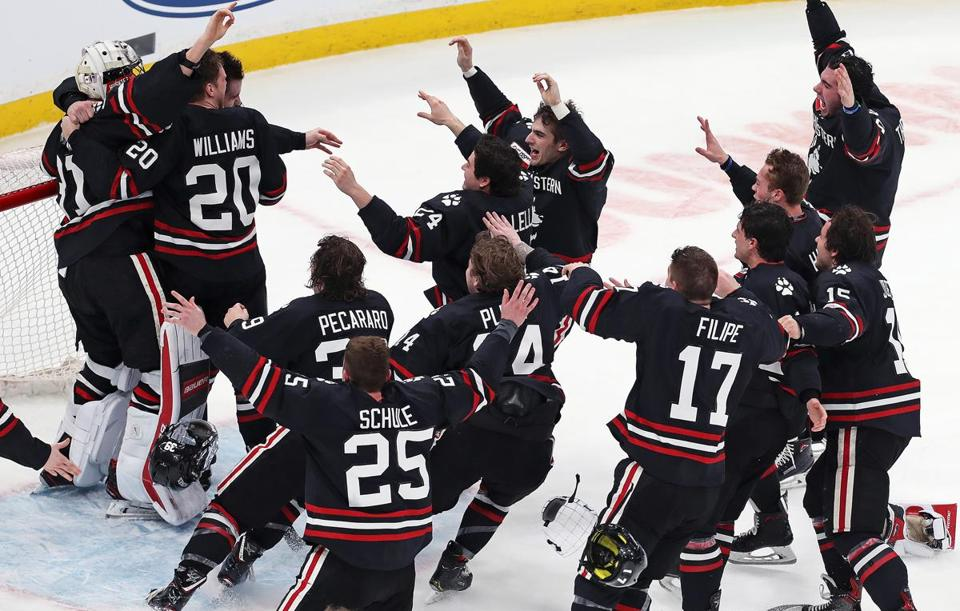 Northeastern players join the celebration with goalie Cayden Primeau after holding off BC.