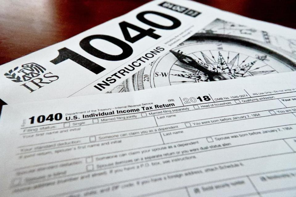 This photo made on Wednesday, Feb. 13, 2019, in Zelienople, Pa., shows mulitiple forms printed from the Internal Revenue Service web page that are used for 2018 U.S. federal tax returns. (AP Photo/Keith Srakocic)