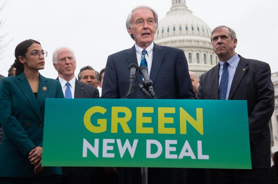 US Representative Alexandria Ocasio-Cortez, Democrat of New York, and US Senator Ed Markey (C), Democrat of Massachusetts, speak during a press conference to announce Green New Deal legislation to promote clean energy programs outside the US Capitol in Washington, DC, February 7, 2019. (Photo by SAUL LOEB / AFP)SAUL LOEB/AFP/Getty Images