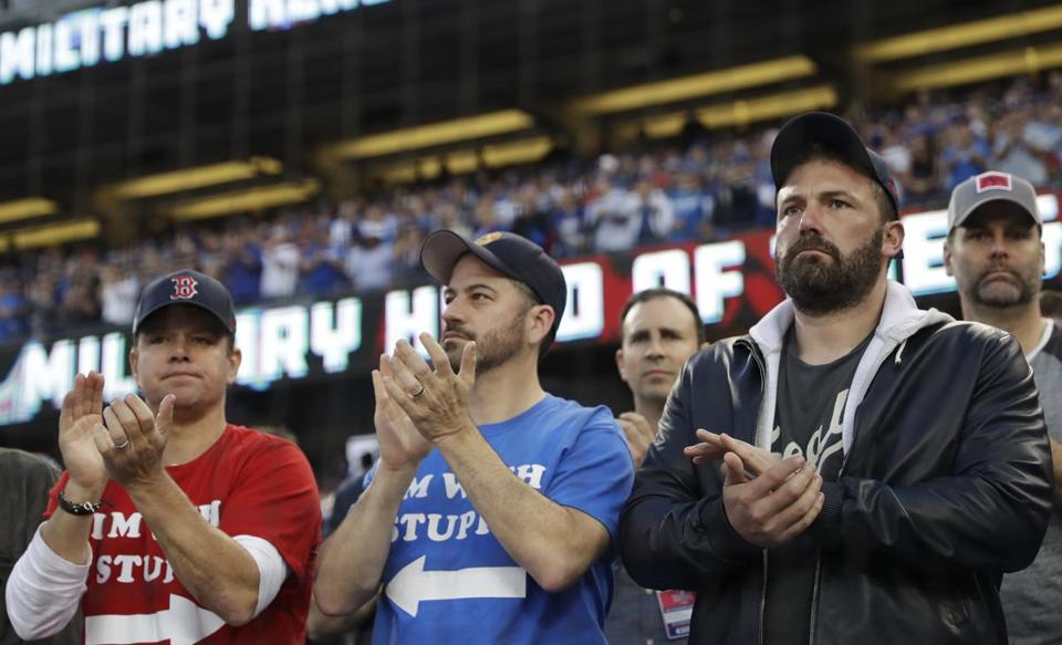From left, Actor Matt Damon, talk show host Jimmy Kimmel and actor Ben Affleck watch Game 5 of the World Series baseball game between the Boston Red Sox and Los Angeles Dodgers on Sunday, Oct. 28, 2018, in Los Angeles. (AP Photo/David J. Phillip)