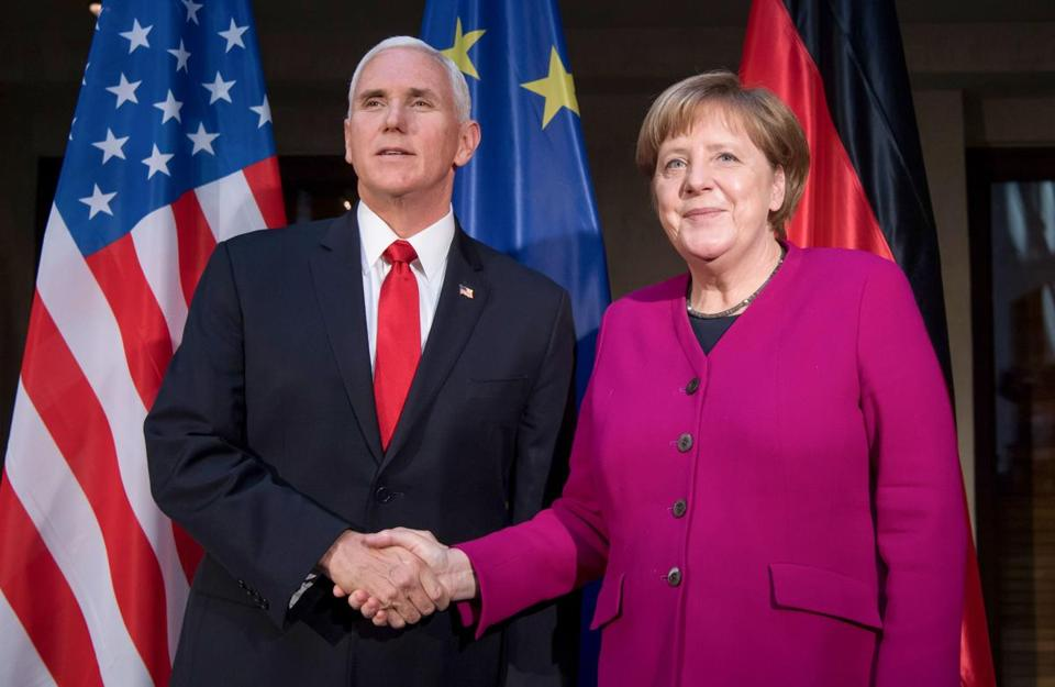 Vice President Mike Pence and German Chancellor Angela Merkel shook hands Saturday at the Munich Security Conference.