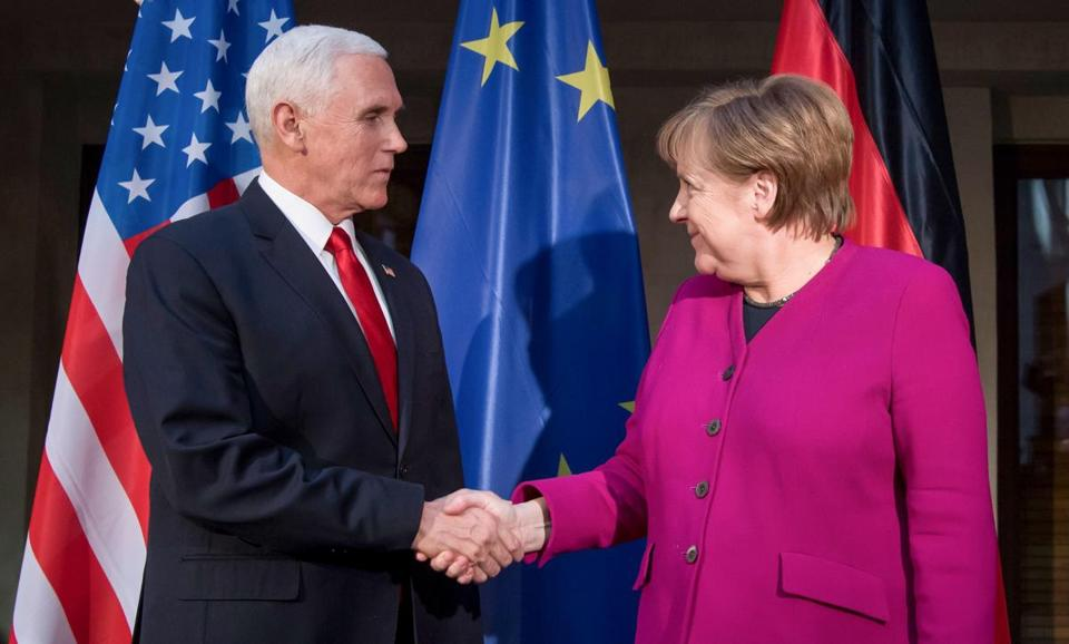 Chancellor Angela Merkel, who shook hands with Vice President Mike Pence in Munich, said the deal was the best way of influencing Iranian behavior on non-nuclear issues.