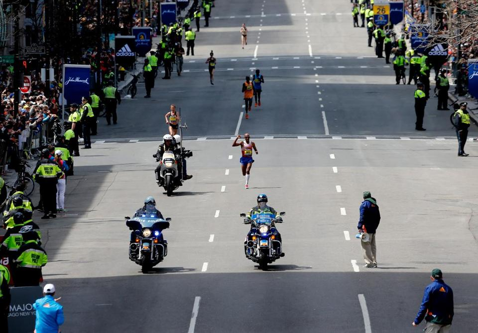 BOSTON, MA - APRIL 21: Meb Keflezighi of the United States approaches the finish line to win the 118th Boston Marathon on April 21, 2014 in Boston, Massachusetts. (Photo by Jim Rogash/Getty Images)