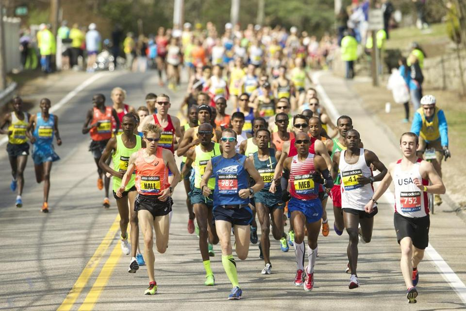 Apr 21, 2014; Boston, MA, USA; Elite runners including Ryan Hall and Meb Keflezighi race during the 2014 Boston Marathon. Mandatory Credit: David Butler II-USA TODAY Sports