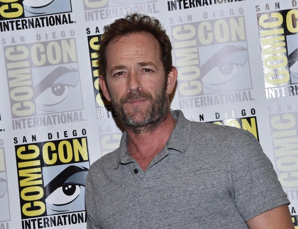 "(FILES) In this file photo taken on July 21, 2018 Actor Luke Perry arrives for the press line of ""Riverdale"" at Comic Con in San Diego. - Actor Luke Perry has been hospitalized after reportedly suffering a massive stroke, US media said February 28, 2019. The ""Beverly Hills, 90210"" star was rushed to the hospital on Wednesday and remains under observation, his representative told various media outlets, declining to elaborate on the actor's condition.Perry, 52, had been in Los Angeles working on the television series ""Riverdale,"" a comic book adaptation in which he plays Fred Andrews. (Photo by CHRIS DELMAS / AFP)CHRIS DELMAS/AFP/Getty Images"