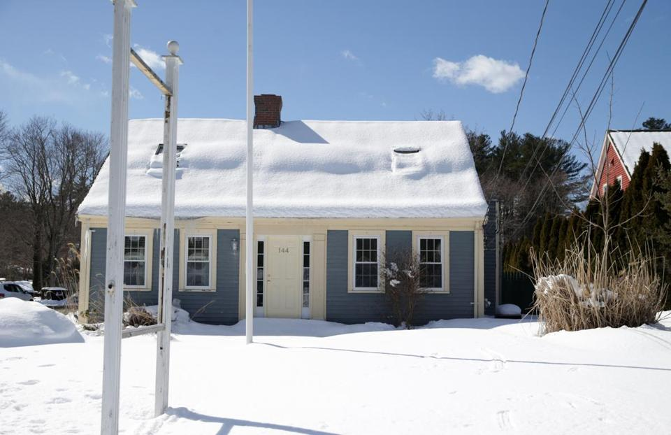 The building at 144 Washington St. in Norwell was raided by police in February.