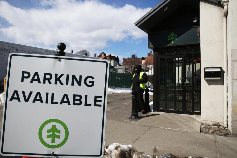 A guard stood outside of New England Treatment Access in Brookline. Because of the minimal street parking in the area, customers are being asked to take public transportation to NETA.