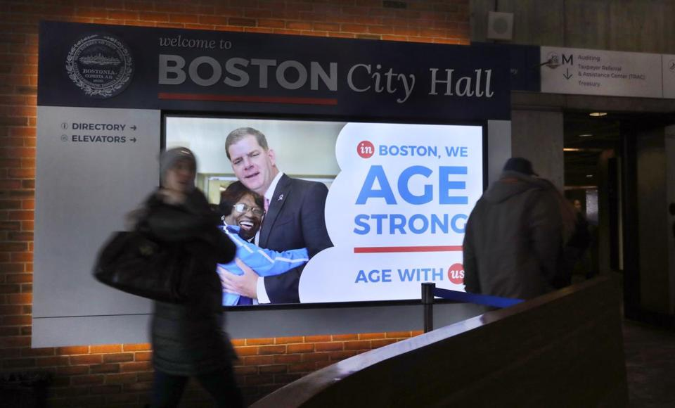 Boston, MA - 3/7/19 The name of the City of Boston's Commission on Affairs of the Elderly (cq) has been officially changed to Age Strong Commission (cq). Signage in City Hall has not been updated yet, but there are digital signs with the new name. This one is near the security entrance. Smaller digital signs are near the elevators. Photo by Pat Greenhouse/Globe Staff Topic: 08olders Reporter: Robert Weisman