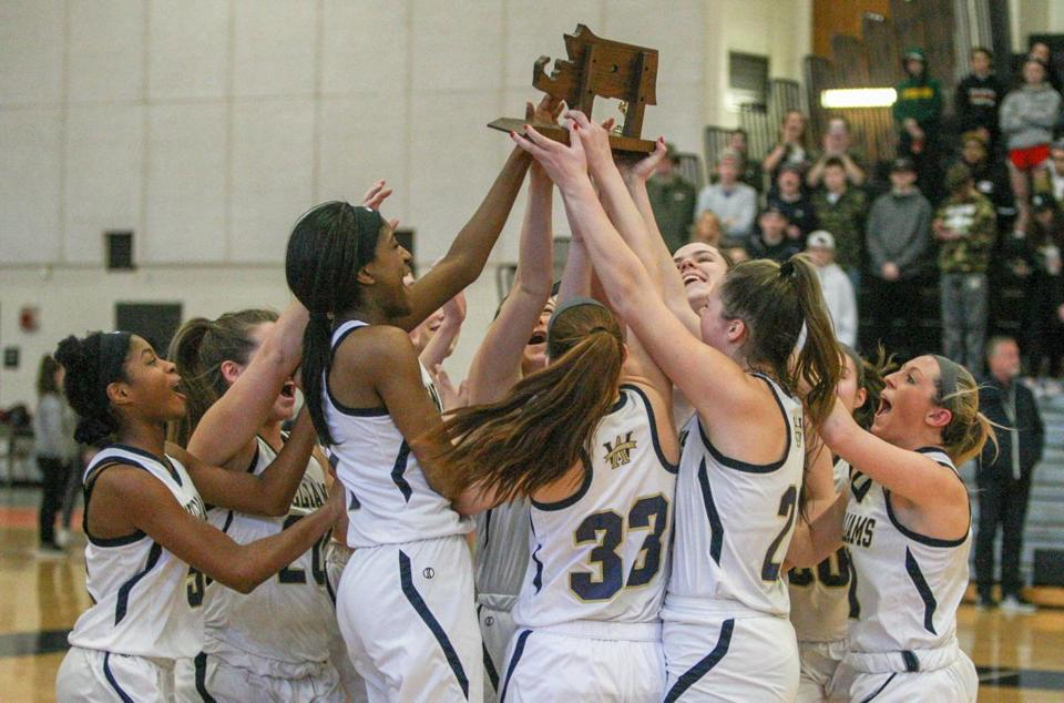 TAUNTON, MA 030919—South basketball finals at Taunton High School. D3 Girls: Apponequet vs. Archbishop Williams. Here, the Archbishop Williams Girls Basketball team rush to celebrate after the official trophy ceremony . (Photo by Steve Haines for The Boston Globe)