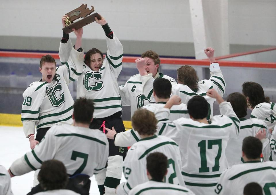 Bourne MA 3/10/19 Canton High John Hagan (19) and Ryan Nolte (22) holding up the trophy after they defeated Westwood High 8-0 winning the MIAA Division D2 South boys' hockey final at Gallo Rink. (photo by Matthew J. Lee/Globe staff) topic: reporter:
