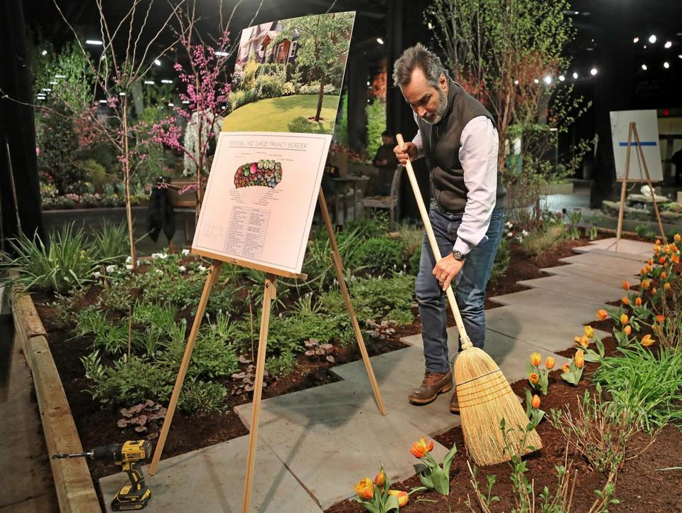 BOSTON, MA - 3/12/2019: Final sweep ups by Steve Gakus from Garden Up, Weston.... Boston Flower & Garden Show that opens on March 13th-17....a touch of springtime indoors at the Seaport World Trade Center in Boston. (David L Ryan/Globe Staff ) SECTION: METRO TOPIC stand alone photo