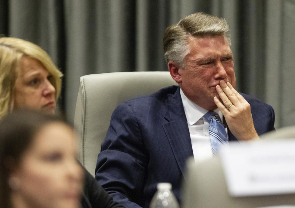 Mark Harris fights back tears as his son John Harris testifies during a public hearing before the North Carolina State Board of Elections in Raleigh, N.C., Feb. 20, 2019. Harris testified that he had warned his father, the Republican candidate in North Carolina's ninth Congressional district, in April 2017 about his misgivings over L. McCrae Dowless Jr., a campaign operative. (Travis Long/Pool via The New York Times) -- FOR EDITORIAL USE ONLY