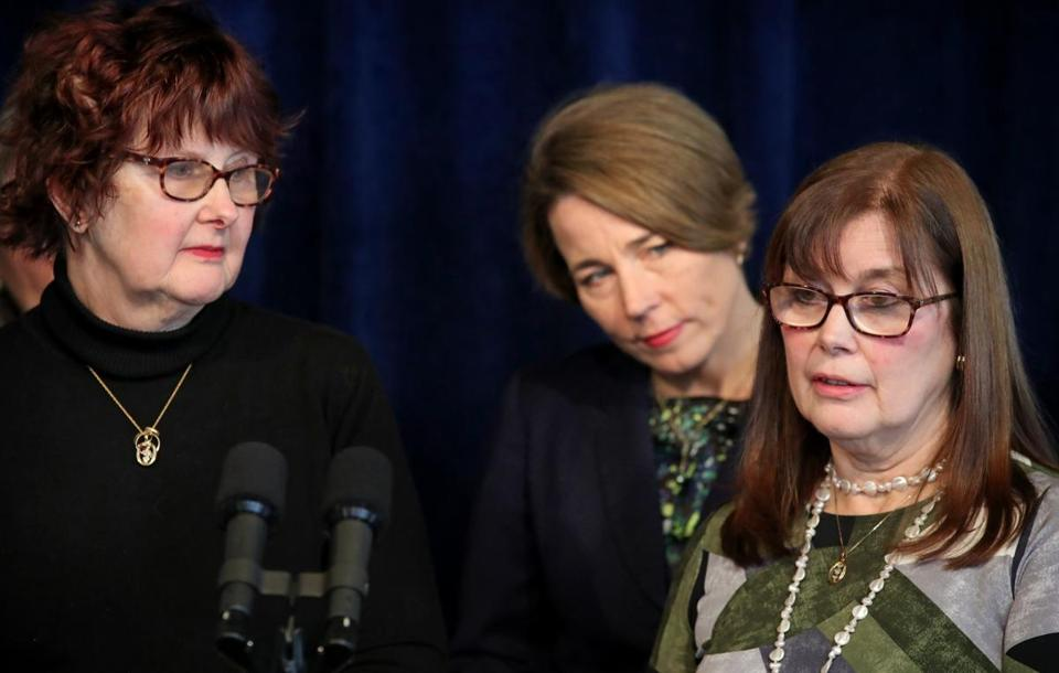 Maura Healey (center) was joined by Candi Hitchcock (left) and her sister Sammi Dawley during a press conference at the Massachusetts attorney general's office in Boston on Wednesday.