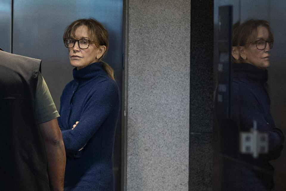 "Actress Felicity Huffman is seen inside the Edward R. Roybal Federal Building and U.S. Courthouse in Los Angeles, on March 12, 2019. - Two Hollywood actresses including Oscar-nominated ""Desperate Housewives"" star Felicity Huffman are among 50 people indicted in a nationwide university admissions scam, court records unsealed in Boston on March 12, 2019 showed. The accused, who also include chief executives, allegedly cheated to get their children into elite schools, including Yale, Stanford, Georgetown and the University of Southern California, federal prosecutors said.Huffman, 56, and Lori Loughlin, 54, who starred in ""Full House,"" are charged with conspiracy to commit mail fraud and honest services mail fraud. A federal judge set bond at $250,000 for Felicity Huffman after she was charged in a massive college admissions cheating scandal. (Photo by DAVID MCNEW / AFP)DAVID MCNEW/AFP/Getty Images"