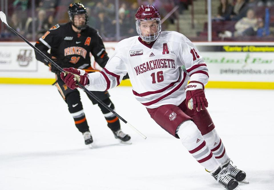 Umass Amherst sophomore defenseman Cale Makar (16) celebrates a goal against Princeton sophomore goaltender Ryan Ferland (30) in the first period at the Mullins Center in Amherst, Massachusetts on November 24, 2018. UMass defeated Princeton 3-2 in overtime. Matthew Healey for The Boston Globe