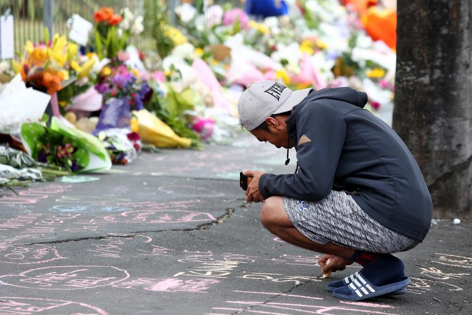 Locals in Dunedin, New Zealand lay flowers and condolences in tribute to those killed and injured.