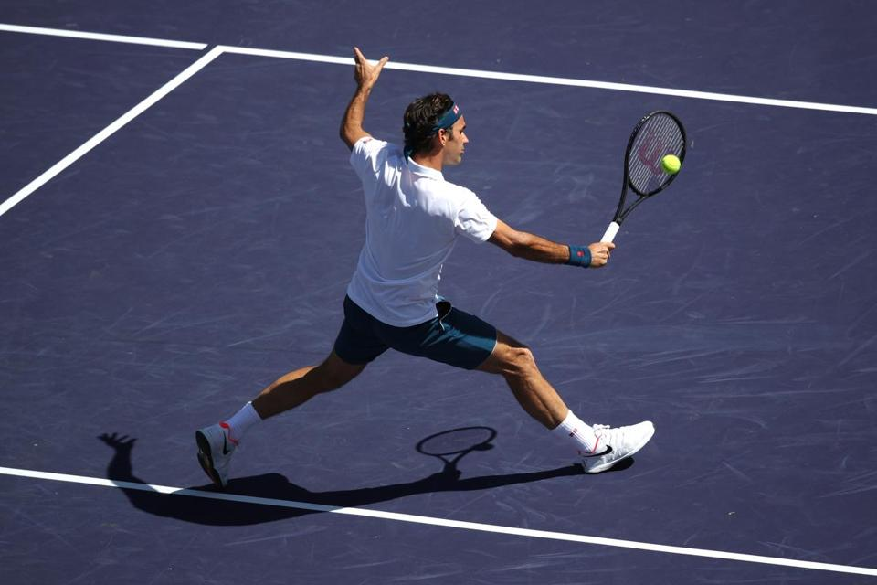 Roger Federer plays a backhand in his win over Hubert Hurkacz in the quarterfinals match of the BNP Paribas Open.