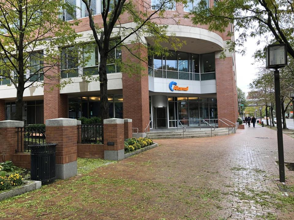 Akamai Technologies says most of the jobs cut were from offices outside Massachusetts.